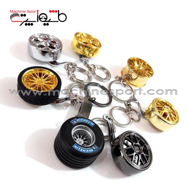 جاسوئیچی زنجیر دار طرح رینگ اسپرت 7 پره طلایی رنگ
